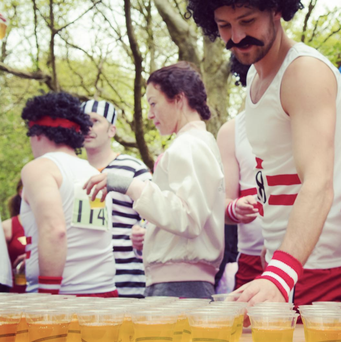 Ciderthon runners in fancy dress grabbing a cider