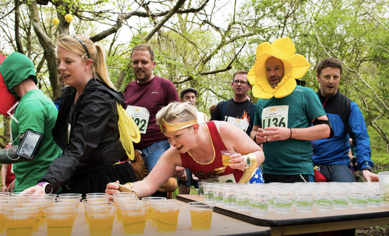 Ciderthon runners at a cider pit stop
