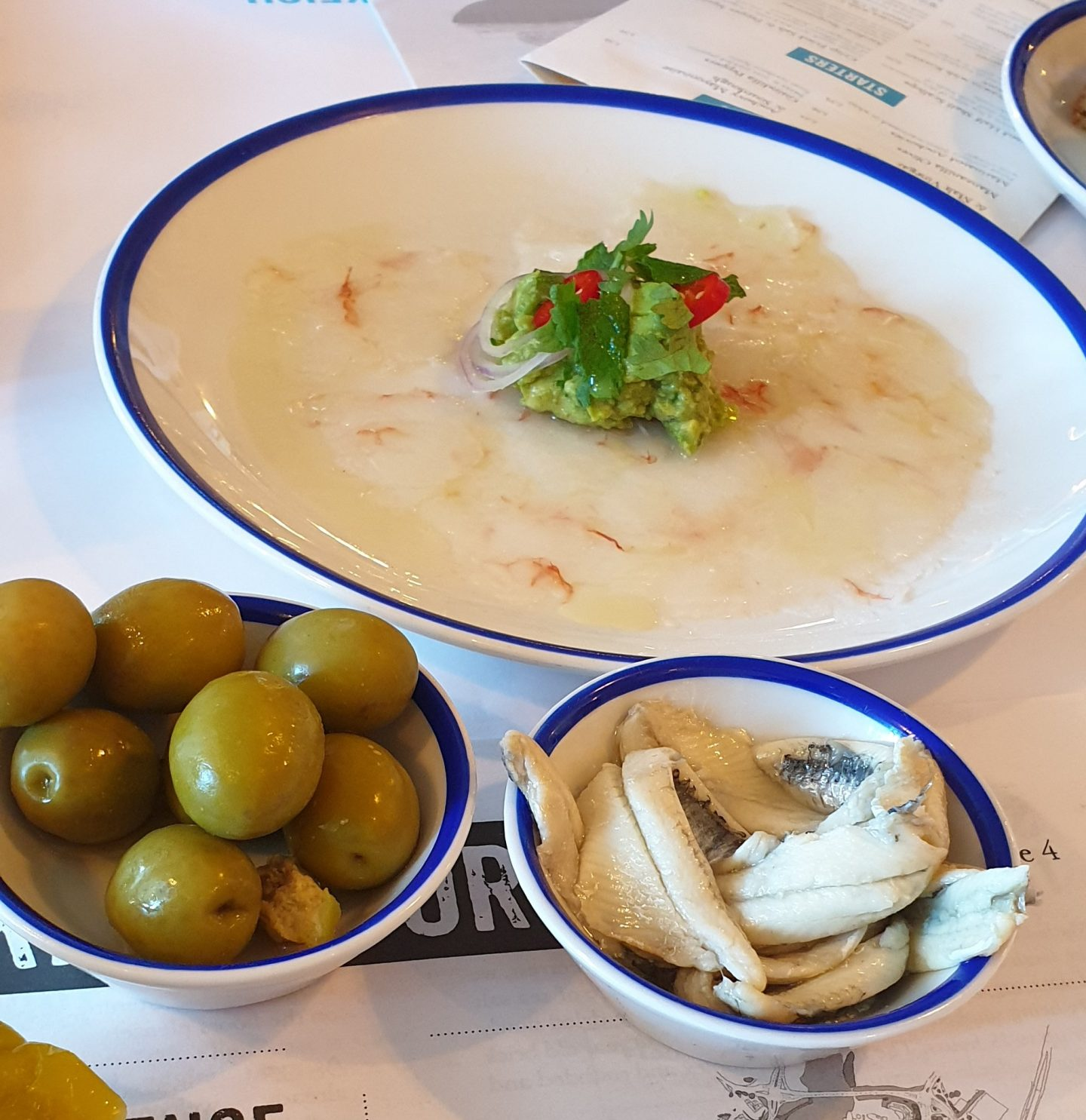 Wild Prawn Carpaccio, with some nibbles – Manzanilla olives & Anchovies