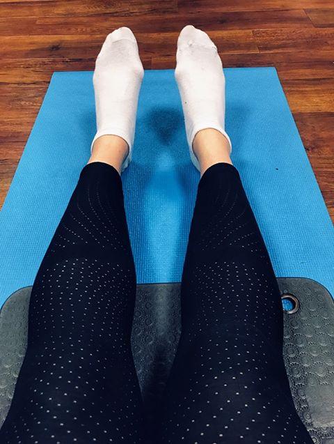 Laura practising Pilates